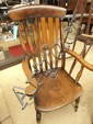 A pair of late 19thC beech splat back armchairs