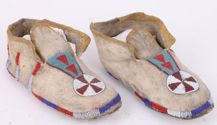 A pair of Northern Plains beaded moccasins