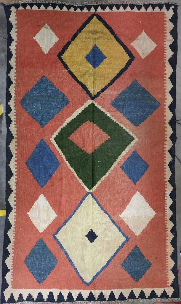 An Afghani room-sized kilim rug