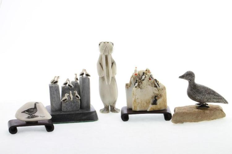 Five Inuit or related decorative art objects