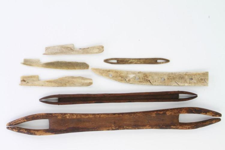 Seven historic Eskimo wood and bone artifacts