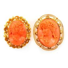 Two coral cameo and 14k gold brooch-pendants