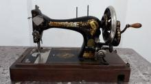 Old Singer sewing machine in a carrying case.