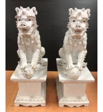 PAIR POTTERY CHINESE FOO DOG GARDEN SCULPTURES.