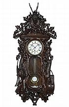 Austrian wall clock with carved case