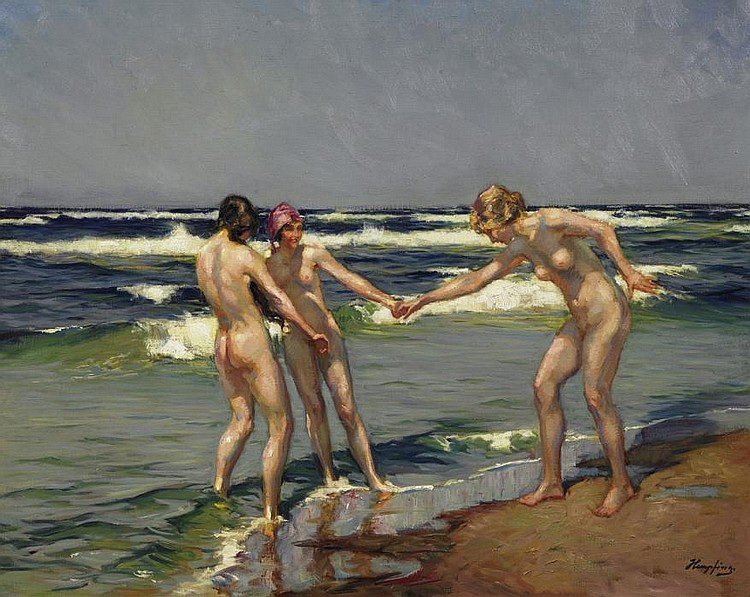 Three young women bathing on the beach.