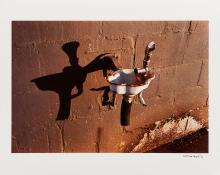 Untitled (drinking fountain / brown wall)