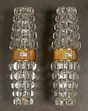 PERZEL Jean (1892 - 1986), Paire d'appliques en verre incolore moulé et bro