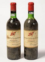 Deux bouteilles Château La Fleur-Pétrus , GC, Pomerol, année 1967. (niveau bas goulot et niveau épaule, une étiquette abîmée).