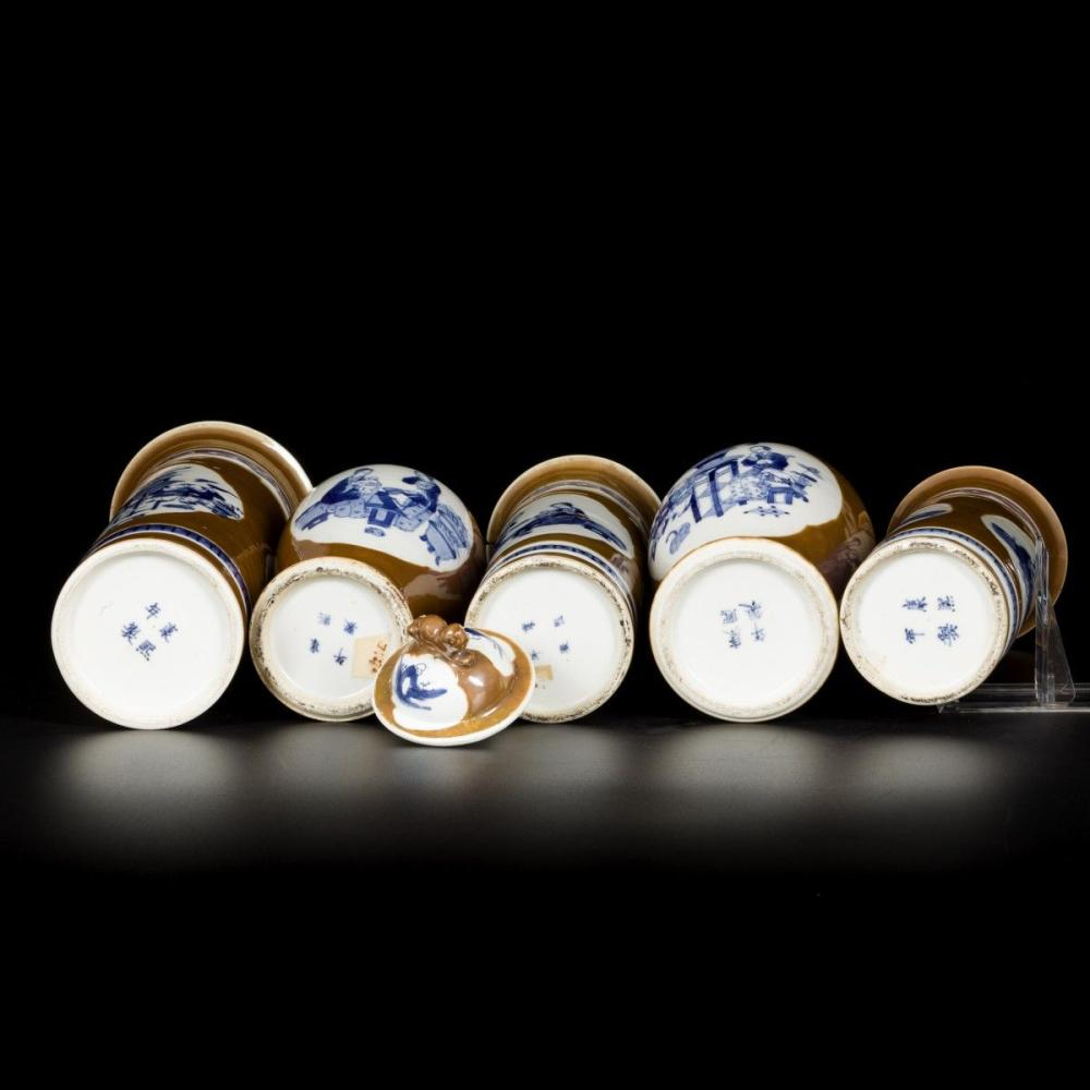 A porcelain garniture set with café-au-lait fond and decorated with Chinese figures, marked Kangxi, China, 19th century.