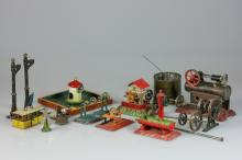 A lot with various old toys, a.w.: a miniature steam engine with burner, cableway, watermill, waterpump, boating pond, some marked: Märklin, Lehman of JF/ BW Bing Nürnberg Spielzeug.