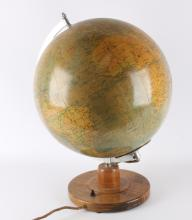 A glass globe on wooden base, mid 20th century.