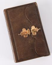 A Bible / Psalm book in brown leather belt with gold buckle, 19th century.
