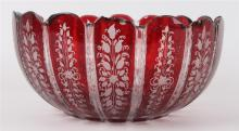 A Bohemian glass bowl with molded rim, around 1900, h 8,5 x 18,5 cm