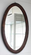 An oval mirror in profile list, 19th century