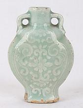 A celadon porcelain snuff bottle with floral decoration, China, 19th century.