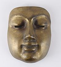 A bronze mask, India.