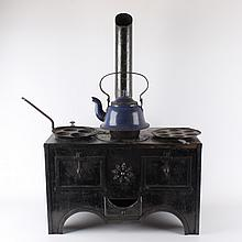 A wrought-iron stove with children's accessories, 19th century.