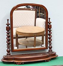 A mahogany oval Biedermeier toilet mirror, 19th century.