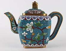 A polychrome decorated cloisson teapot with flora 19th century.