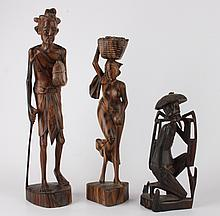 Three stabbed wooden figures, Indonesia, circa 1930.