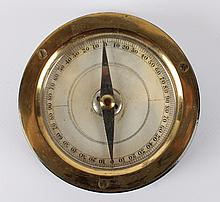A brass and ebonised wooden compass card