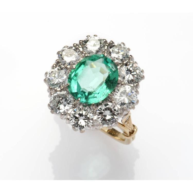 a 14k gold emerald and dress ring