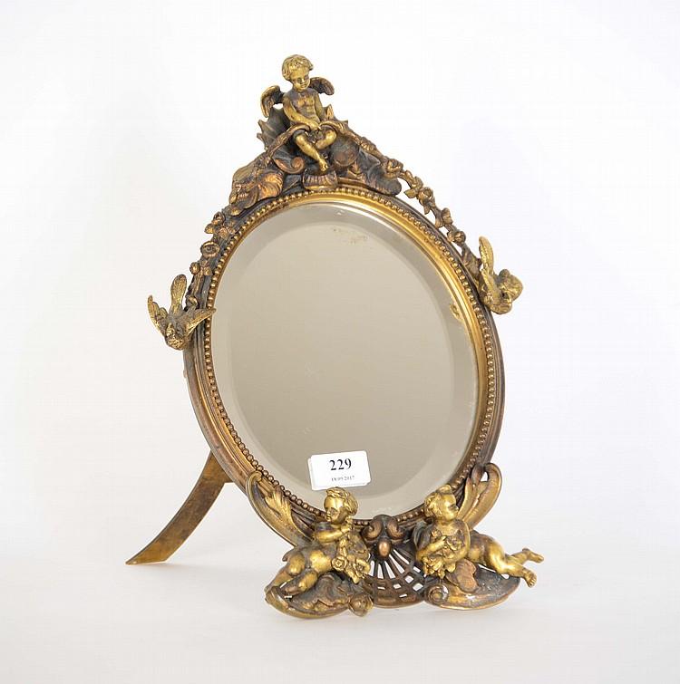 Miroir poser en bronze dor aux amours de style r gence for Miroir hauteur 90