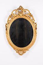 A Louis XVI style oval mirror