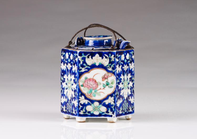 A tea pot with warmer