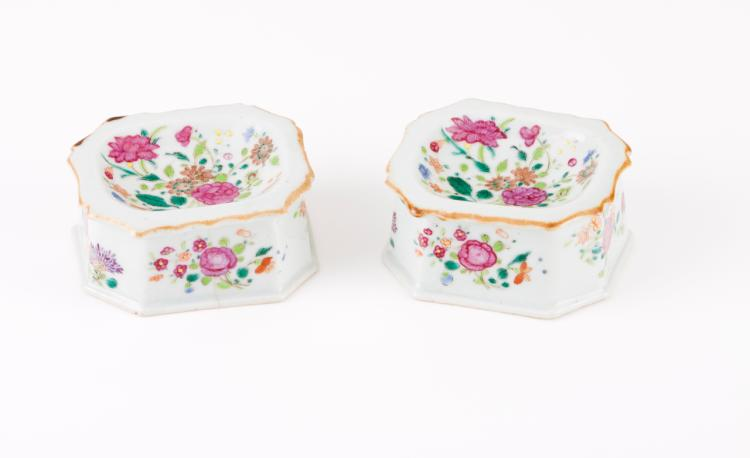 A pair of scalloped salt cellars