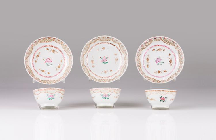 A set of three bowls and saucers
