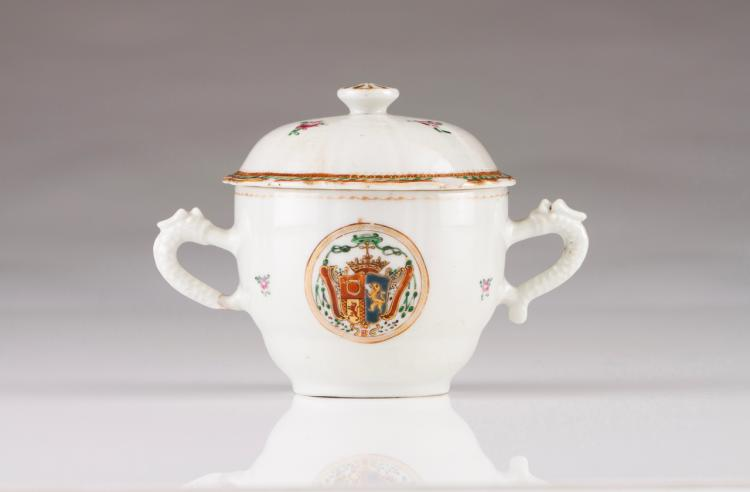 A sugar bowl with scalloped cover