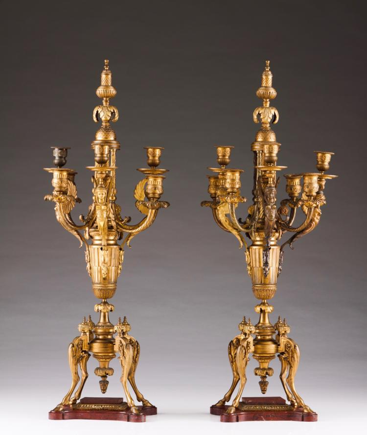 A pair of Empire seven-light candelabra