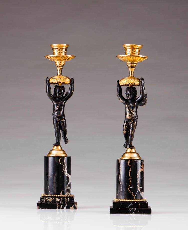 A pair of Louis Philippe candlesticks