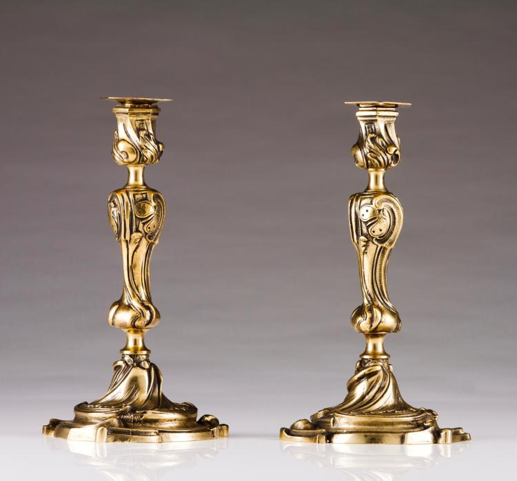 A pair of Louis XV style candlesticks
