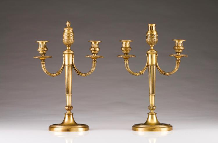 A pair of Louis XVI style three-light candelabra