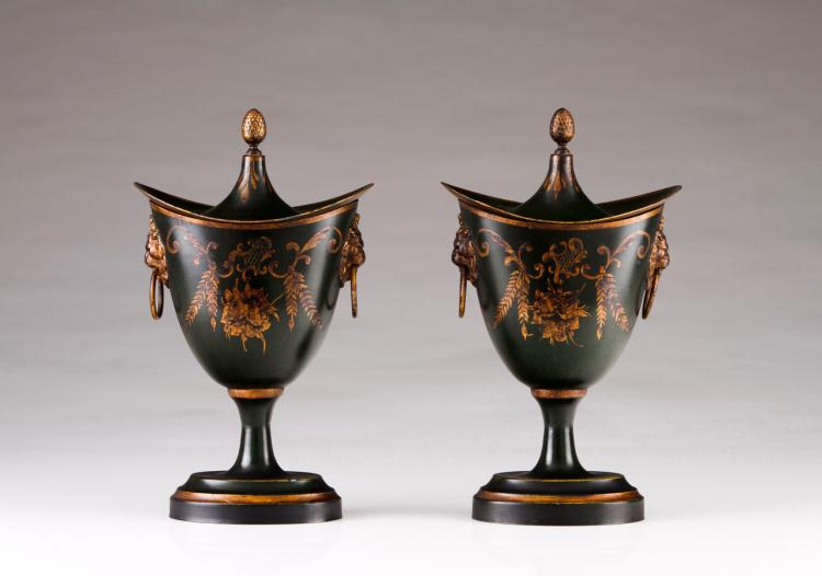 A pair of Regency style urns with cover