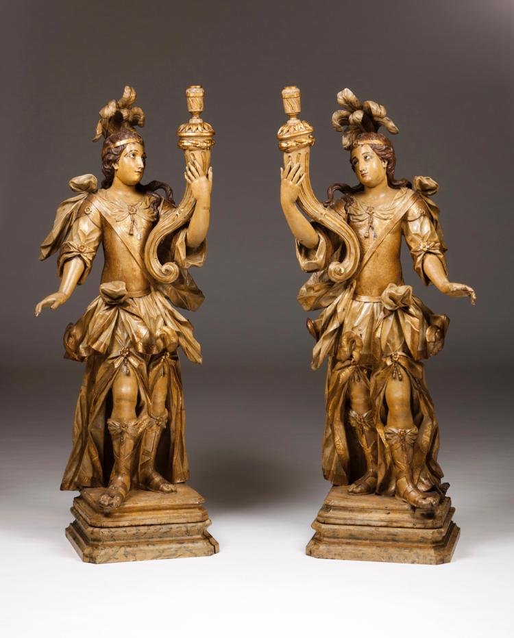 A pair of candlestick sculptures