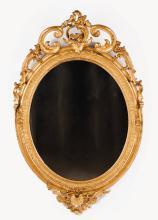 An oval Romantic mirror