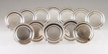 A Portuguese silver set of twelve bread plates