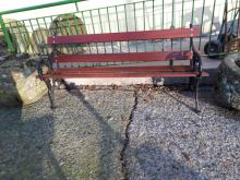 Pair of cast iron garden seat with wooden slats.
