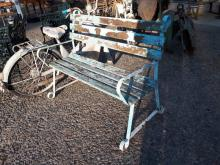 Wrought iron garden seat with wooden slats.