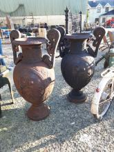 Pair of decorative cast iron garden urns in the Neo - Classical style.