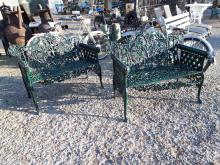 Pair of decorative cast iron garden benches with ram heads.