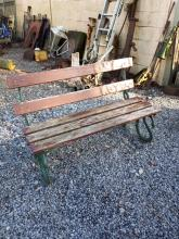 Cast iron garden seat with wooden slats.