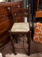 Three pine bar stools with rush seats.