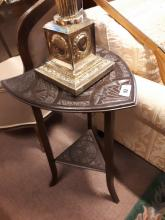 Edwardian walnut wine table the top in the form of a shield.
