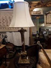Brass table lamp with corinthian column and cloth shade.