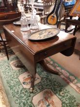 Georgian mahogany double drop leaf sofa table with turned column with four
